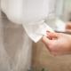 paper-towel-dispenser-hand-woman-takes-paper-towel-bathroom_118454-4746